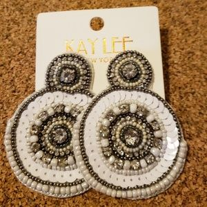 White and silver earrings